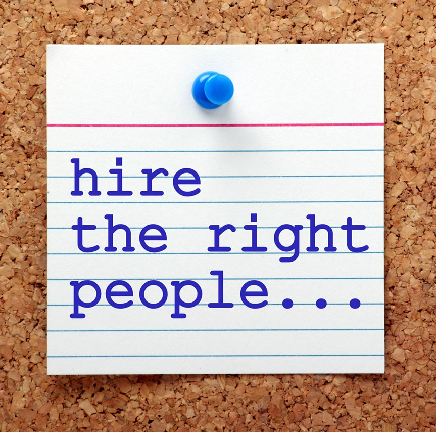 "the words ""hire the right people"" tacked to a cork board"